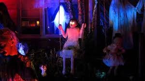 creepy on a swing at decorated halloween house youtube