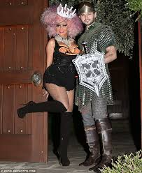 christina aguilera spills out of halloween costume as she