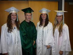 white cap and gown reporter s notebook west perry grads don green and white gowns