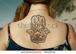 henna tattoo mehendy painted on back stock photo 498405148