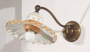 applique in cotto applique in ottone invecchiato con snodo alla base piatto in