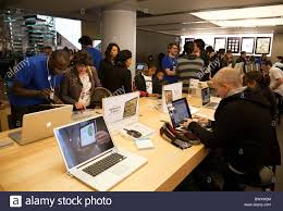 customers in the apple store the louvre art gallery paris france