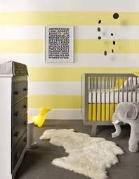 stylish baby room with stripes walls and grey crib also modern
