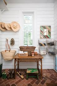 the combination of shiplap walls and brick tile floors creates the