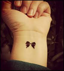tattoo on finger bow 60 sexy bow tattoos meanings ideas and designs for 2018