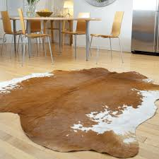 decorating exciting cow hide rug on kahrs flooring and mid