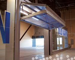 architecture designer designer canopy type bifold garage doors throughout plan 6