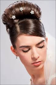hair crystals stick pin hair crystals with white veil tacked onto back of bun