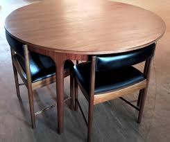 mcintosh extending circular dining table with flush fitting chairs