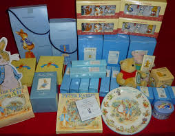 collection of winnie the pooh and beatrix potter ornaments by
