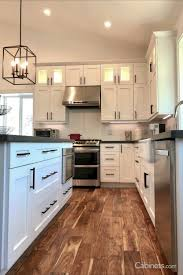white shaker kitchen cabinets wood floors adding warmth to a white kitchen white kitchen wood floors