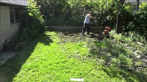 tilling the lawn with a troy bilt tiller backyard landscaping