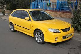 ridiculous rebadges the mazda 323 ford u0027s first u0027world car u0027