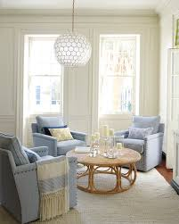 lighting interesting living room with light blue sofa and wicker