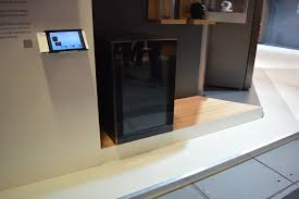 this attractive wine fridge is cooled entirely by magnets