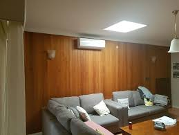 need ideas for decorating a large wood panel wall