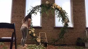 wedding ceremony trellis back drop white dahlias and greenery