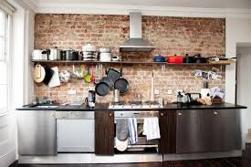 delightful industrial brick kitchen featuring brown brick wall and