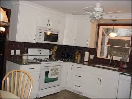 white kitchen cabinets with beadboard backsplash monsterlune