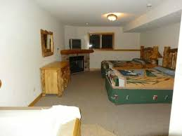 grizzly jacks grand bear resort wedding ceremony second bedroom in basement it has fireplace and attached bathroom