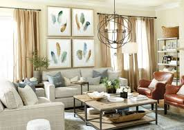 15 ways to layout your living room how to decorate shop orb chandelier durham rectangular coffee table durham tall bookcase fringed burlap panel durham tray table feather study art dixon leather chair