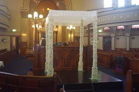 chuppah poles chuppah with lace canopy and white floral poles leanne simmons
