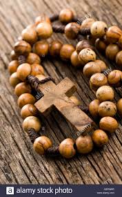 wooden rosary wooden rosary on wooden background stock photo 41352803