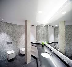 modern bathroom design with tankless white wall hung toilets and