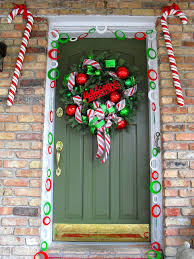 50 best christmas door decorations for 2017 welcome to candy cane lane door decoration