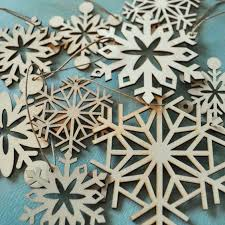 snowflakes laser cut wood and snowflake ornaments on