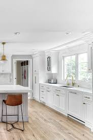 white kitchen cabinets wood floors 70 white cabinets with white countertop going out of