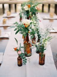 jar floral centerpieces glass bottles fill in as gorgeous wedding centerpieces