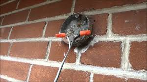 outdoor electrical box for light how to use a pancake box lots of mortar along the footing bricks