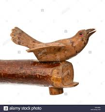 antique carved wooden bird whistle stock photo royalty free