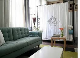 small studio apartment design living room with beige sofa and