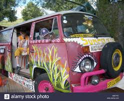 volkswagen van hippie old flower child vw bus with lot of hippie painting parking europe