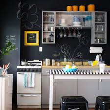black walls white kitchen cabinets big ideas for a small city apartment an interior decorator