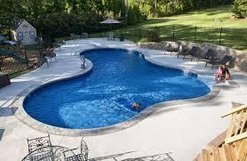 Backyard Pool Landscaping Ideas by Backyard Fire Pits Backyard Creations Umbrella Backyard Pool