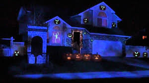 halloween ghost lights a whole show projected on to a house for halloween projection