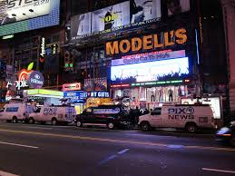 news trucks outside modell u0027s sporting goods on 42nd street u2026 flickr