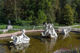 ornamental statues in a pond outside the imperial kaiservilla