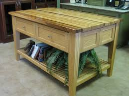 oak butcher block island with drawer also single rail shelf for