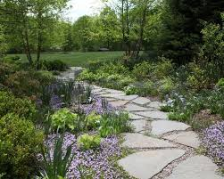 How To Lay A Paver What To Know About Installing A Walkway Of Pavers And Pebbles