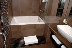brown and white bathroom ideas corner white bath up combined with toilet and sink placed on oval