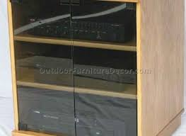 light brown wooden maple kitchen cabinets with glass doors and