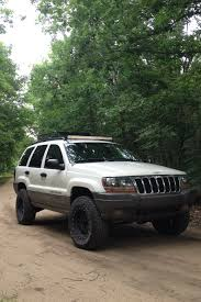 jeep wj roof lights jeep grand cherokee wj lifted 2 light bar roof rack method race