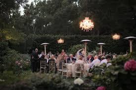 backyard wedding with medium and small crystal chandeliers bella