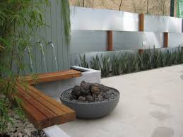 faux fire bowl green form woven steel wall and water feature