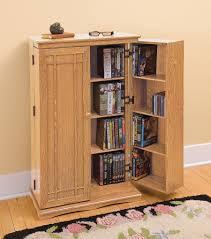 Oak Dvd Storage Cabinet Dvd Cabinet With Glass Doors Door Design