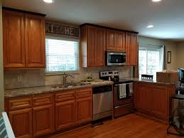 local business spotlight lisa fuller 1 shabby chic kitchen and kitchen before painting cabinets